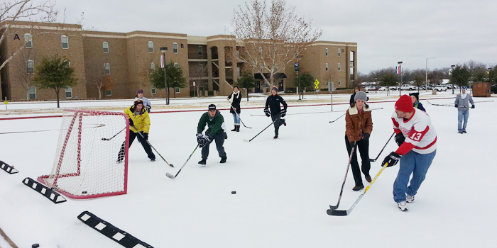 ACU image ice hockey snow day photo by Noah Kitts