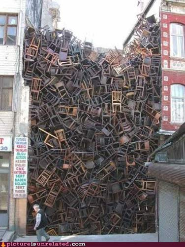 Wall of chairs from picture is unrelated.com